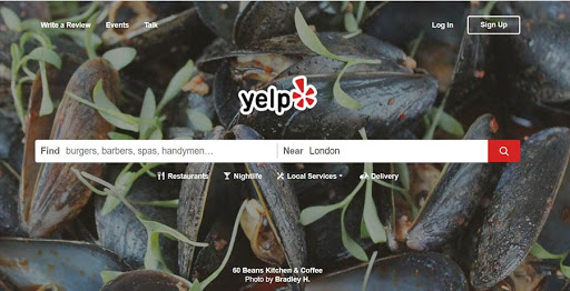 The Yelp home page with a search bar.